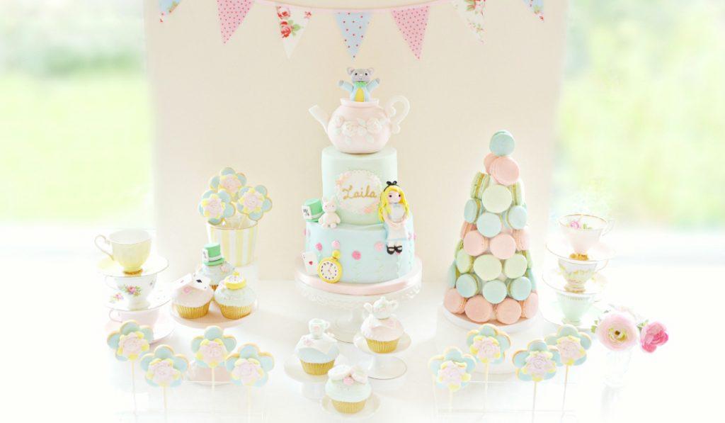 Alice-in-Wonderland-Theme-Cake-Pastel-Macarons-Tower-Cupcakes-and-Cookie-Pops-Birthday-Party-Cake-Table-Cherie-Kelly-London-0